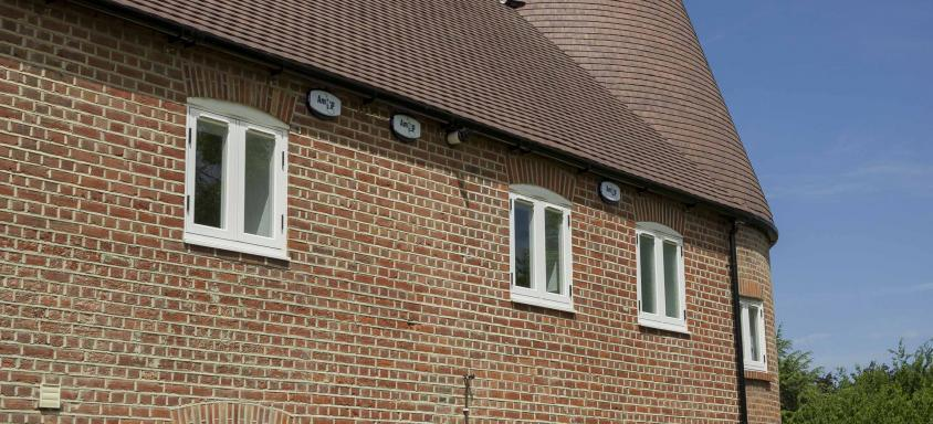 White Double Glazed Windows On Brick Home