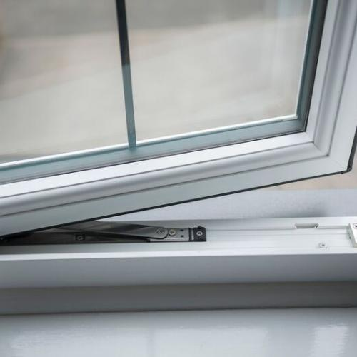 R7 White Rehau Tilt And Turn Windows open window showing grain and hinge