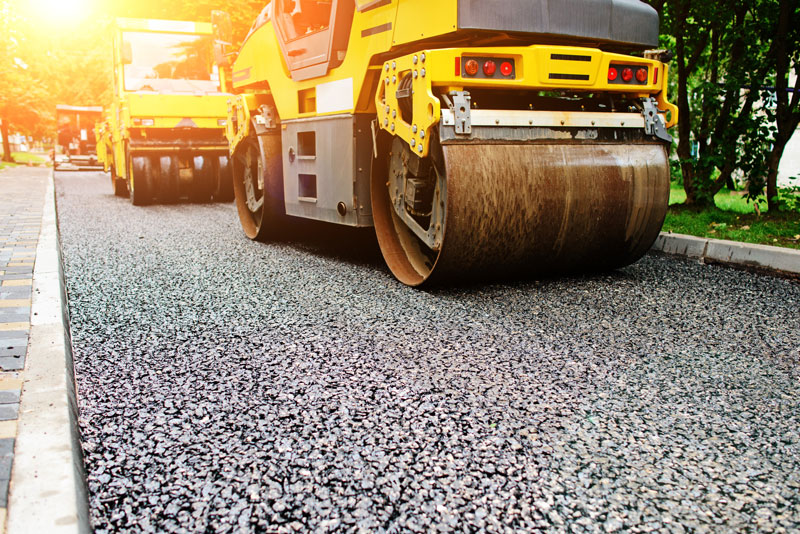 can asphalt be laid on top of concrete