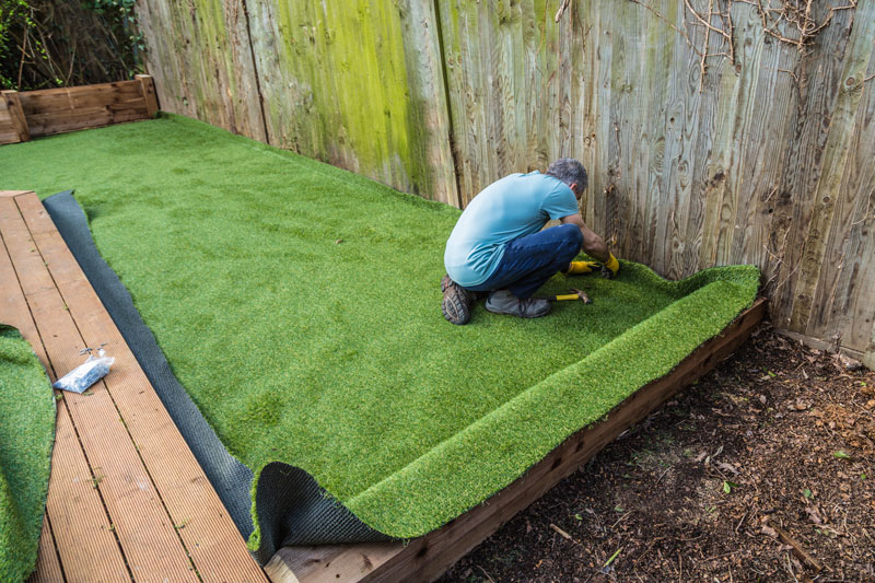 does artificial grass complement a resin driveway